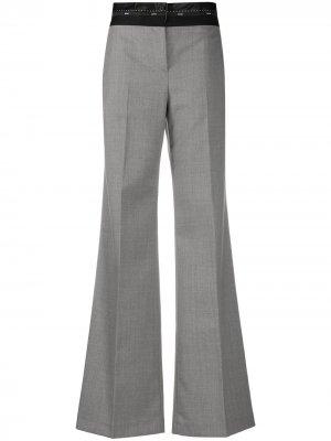 Расклешенные брюки с логотипом на поясе MSGM. Цвет: серый