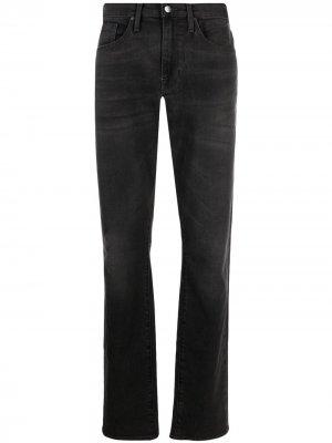Узкие джинсы средней посадки FRAME. Цвет: черный