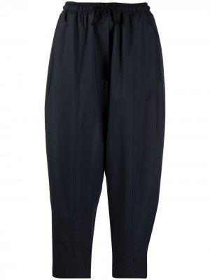 Укороченные зауженные брюки Odeeh. Цвет: синий