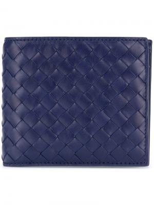 Кошелек с фирменным плетением intrecciato Bottega Veneta. Цвет: синий