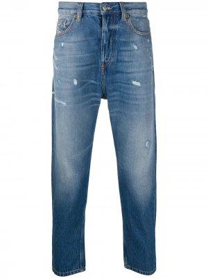 Зауженные джинсы с эффектом потертости Diesel. Цвет: синий