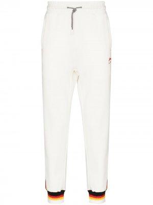 Спортивные брюки с лампасами Li-Ning. Цвет: белый