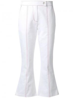 Расклешенные укороченные брюки MSGM. Цвет: белый