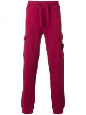 Спортивные брюки с карманами-карго Stone Island. Цвет: розовый