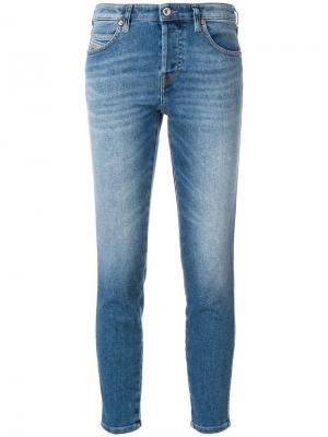Укороченные джинсы скинни с рваным деталями Diesel. Цвет: синий