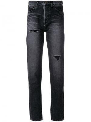 Зауженные джинсы с потертой отделкой Saint Laurent. Цвет: черный