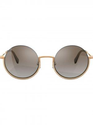 Солнцезащитные очки в круглой оправе Miu Eyewear. Цвет: золотистый