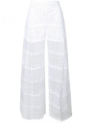Расклешенные кружевные брюки Charo Ruiz. Цвет: белый