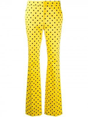 Расклешенные брюки в горох Moschino. Цвет: желтый