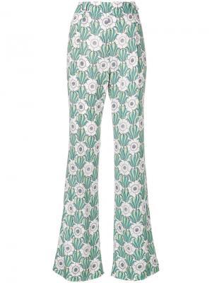 Расклешенные брюки с цветочным принтом Prada. Цвет: зеленый