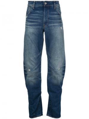 Суженные книзу джинсы G-Star. Цвет: синий