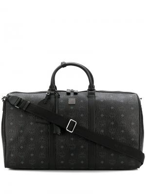Дорожная сумка с монограммным принтом MCM. Цвет: черный