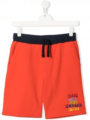 Плавки-шорты с надписью North Sails Kids. Цвет: красный