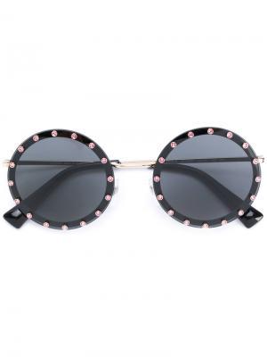 Солнцезащитные очки в круглой оправе Valentino Eyewear. Цвет: черный