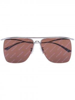 Солнцезащитные очки с логотипом Balenciaga Eyewear. Цвет: коричневый